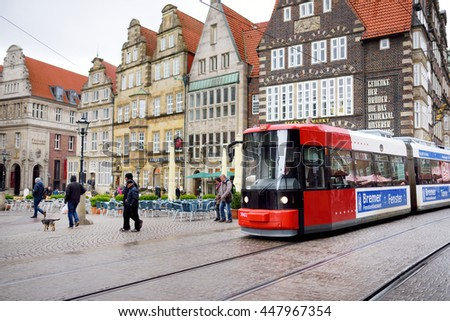 BREMEN, GERMANY - MARCH 23, 2016: Tram stopping by historic houses on the Market Square. In July 2004 the buildings were listed as a UNESCO World Heritage Site.