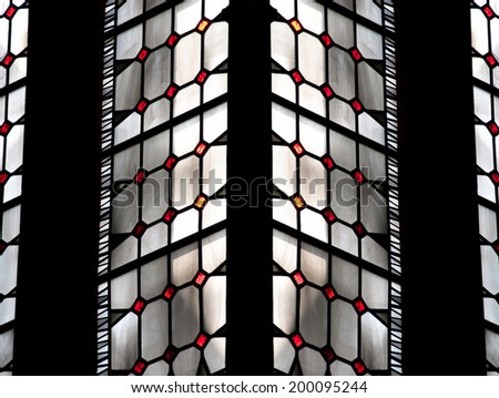 BREMEN, GERMANY - MAY 26, 2010: Multicolored pearl stained glass window in symmetric pattern in Bremen Catholic cathedral  - stock photo