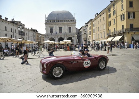 BRESCIA (BS), ITALY - MAY 14: A dark red Fiat 1100 Colli Sport takes part to the 1000 Miglia classic car race on May 14, 2015 in Brescia (BS). The car was built in 1951. - stock photo