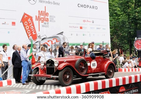 BRESCIA (BS), ITALY - MAY 14: A red Alfa Romeo 6C 1750 GT starts the 1000 Miglia classic car race on May 14, 2015 in Brescia (BS). The car was built in 1930. - stock photo