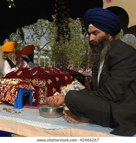 BRESCIA, ITALY - APRIL 30: Sikh Indians offer sacred bread during 'Baisakhi' celebration April 30, 2005 in Brescia, Italy.  20,000 Sikh Indians residing in Italy celebrate the annual procession.