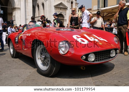 BRESCIA, ITALY - MAY 12 : A 1955 built red Ferrari Mondial waits for the sealing (final compliance check) for 1000 Miglia race on May 12, 2011 in Brescia.