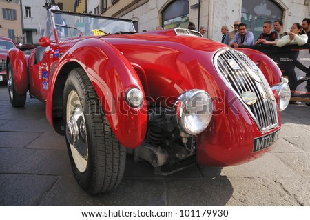 BRESCIA, ITALY - MAY 12 : A 1950 built red Healey Silverstone waits for the sealing (final compliance check) for 1000 Miglia race on May 12, 2011 in Brescia. - stock photo