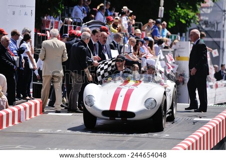 BRESCIA, ITALY - MAY 18: A red-striped white Maserati A6 GCS/53 Fantuzzi finishes the 1000 Miglia classic car race on May 18, 2014 in Brescia. The car was built in 1954 - stock photo