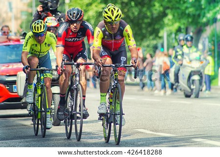 """Brescia, Italy - May 25,2016: Eugert Zhupa, Daniel Oss and Pavel Brutt, Sprint in partial finish in 17th stage of the """"Giro d'Italia"""" - stock photo"""
