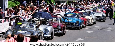 BRESCIA, ITALY - MAY 18: Seven Mercedes Gullwing in a row, and a single Porsche 356, take part to the 1000 Miglia classic car race on May 18, 2014 in Brescia. The car were all built in 1955 - stock photo