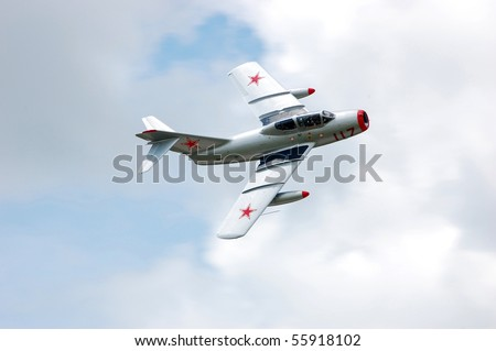 BRESLAU, ON, CANADA - JUNE 20: A Mig-15, a Russian aircraft type that won fame during the Korean War, performs at the Waterloo Aviation Expo and Air Show on June 20, 2010 in Breslau, Ontario. - stock photo