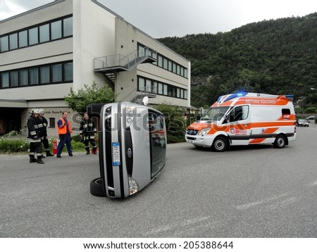 BRESSANONE BRIXEN, ITALY - MAY 20, 2011: car turned upside down after road crash collision with intervention of Firefighters and Paramedics in Bressanone Brixen, on May 20, 2011