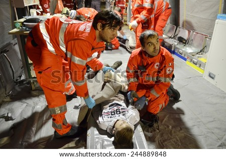 BRESSANONE, ITALY - NOVEMBER 16, 2014: Two doctors working inside a hospital field tent for the first AID. Camp room for the rescue of injured people after flood on November 16, 2014. - stock photo