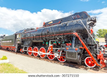 Brest, Belarus - July 12, 2015: Old steam locomotive parked. Coal-fired steam locomotives played a crucial role in the economy of the last century.
