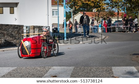 Bretignolles sur Mer, France - October 29, 2016 : old pedal car race organized in city street. Participants are dressed in the colors of their car.