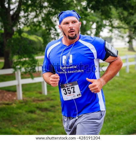 BREVARD, NC-MAY 28, 2016 -Dusty Robinson of Brevard runs in the White Squirrel Race with over 350 runners in Brevard, NC 2016.  Race is sponsored by Rotary Club of Brevard, NC - stock photo