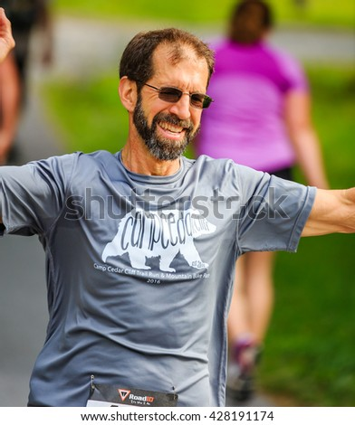 BREVARD, NC-MAY 28, 2016 - Man runs in the White Squirrel Race with over 350 runners in Brevard, NC 2016.  Race is sponsored by Rotary Club of Brevard, NC - stock photo