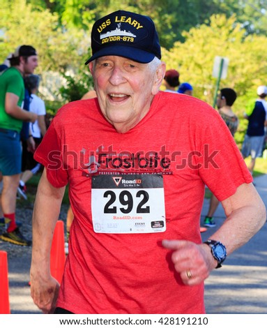 BREVARD, NC-MAY 28, 2016 - Senior Man runs in the White Squirrel Race with over 350 runners in Brevard, NC 2016.  Race is sponsored by Rotary Club of Brevard, NC - stock photo