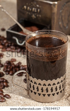 Brewed coffee in a glass .