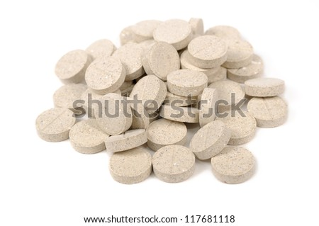 Brewer's Yeast Tablets for Cats and Dogs Isolated on White Background - stock photo