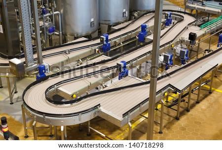 Brewery, conveyor, top view - stock photo