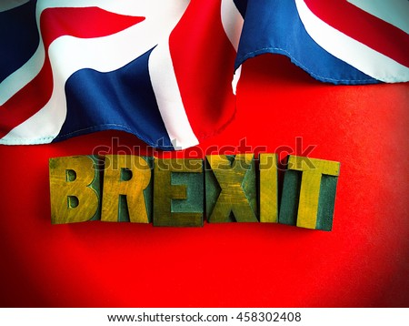 Brexit word with part of British flag on red - stock photo