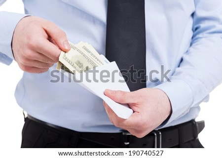 Bribe. Cropped image of man in shirt and tie taking money from the envelope while standing isolated on white