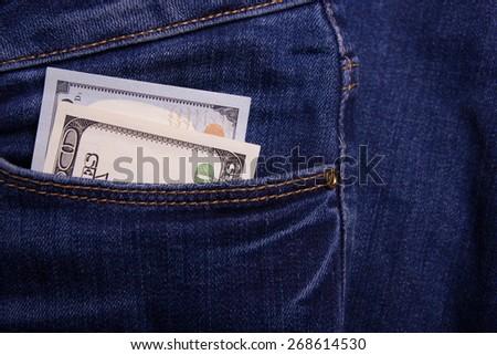 Bribe in businessmen's pocket. One hundred dollars banknote - stock photo