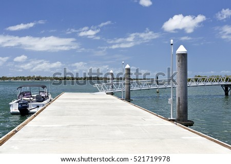 BRIBIE ISLAND, AUSTRALIA - November 20, 2016: View of the floating dock and ramp of the new recreational pier at the Pumicestone Passage near the bridge to the Bribie Island, Queensland, Australia