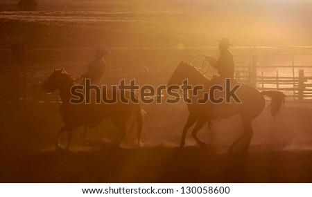 BRICE CANYON CITY, UTAH - JUNE 25: Cowboys ride their horses at a rodeo show at Ruby's Inn Bryce Canyon Country Rodeo on June 25, 2011 in Brice Canyon City. - stock photo