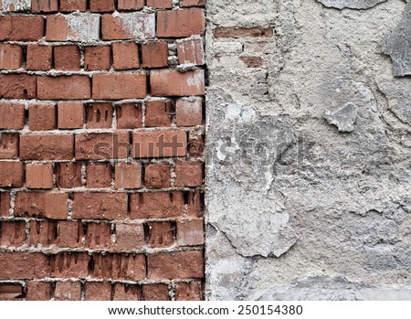Brick and cement wall split in middle - stock photo