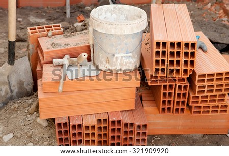 Brick and construction tools in the work - stock photo