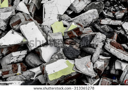 Brick and rubble on a cobbled road in Thailand - stock photo
