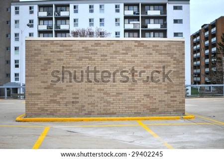 "Brick building in parking lot ""back"" - stock photo"