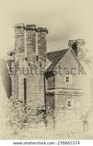Brick built mansion vintage effect with three brick chimneys. Showing end gable. The mansion was probably built in the eighteenth or nineteenth Century - stock photo