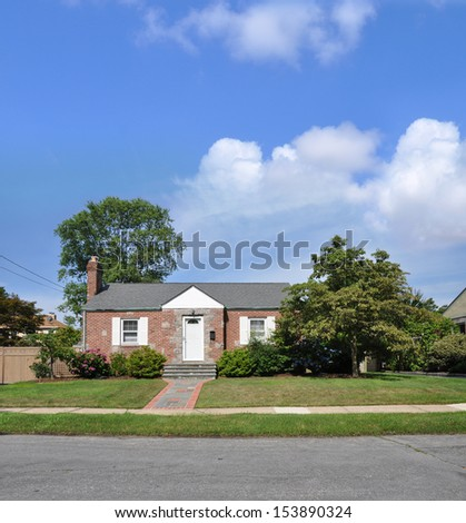 Brick Bungalow Cottage Style Home Sunny Blue Sky Day Suburban Residential Neighborhood