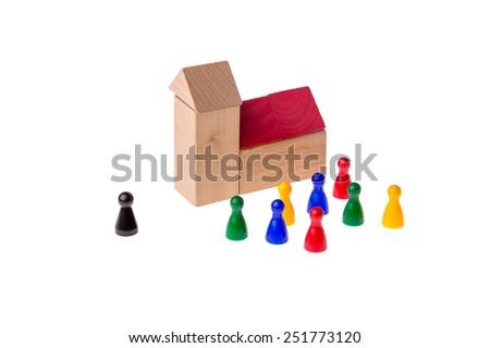 Brick church with different game pawns around it - stock photo