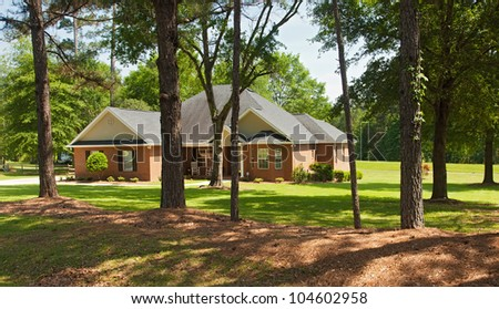 Brick colonial home in rural Florida in the countryside - stock photo