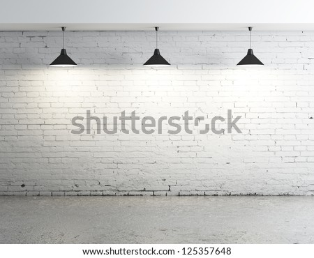 brick concrete room with three ceiling lamps - stock photo