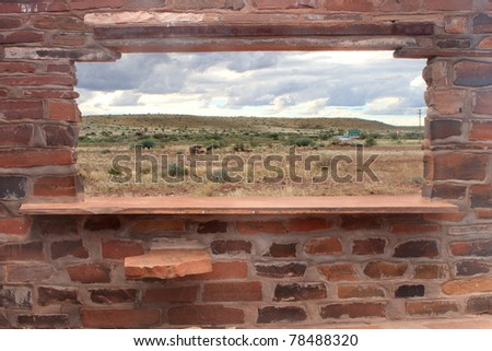 Brick counter and window with scenic background - stock photo