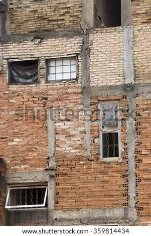 brick facade of residence in slum on sao paulo, brazil - stock photo