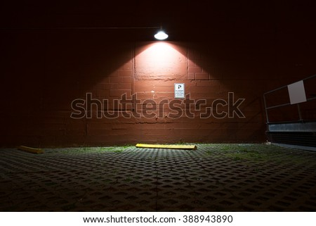 brick floor and  wall with a light in seattle at night