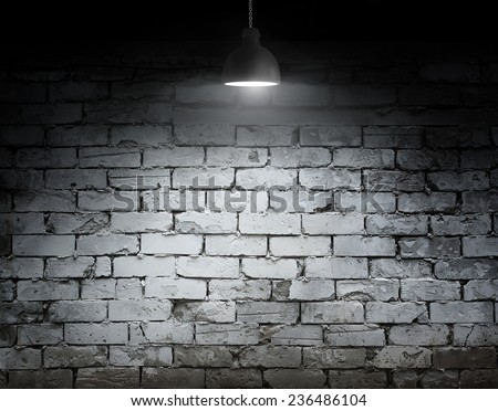 brick grunge wall and ceiling lamp - stock photo