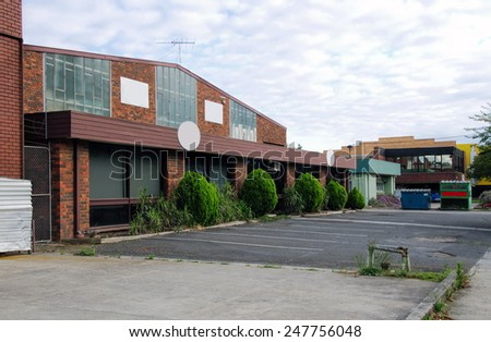 brick office building with parking space - stock photo