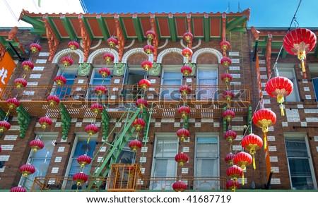 brick, orange and green building in Chinatown, San Francisco, California - stock photo