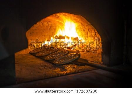 brick oven bread production - stock photo
