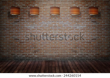 brick room with ceiling lamp - stock photo