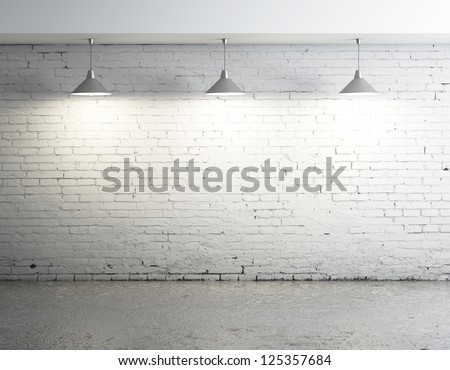 brick room with three ceiling lamps - stock photo