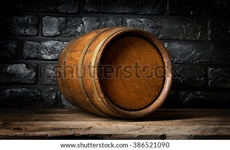 Brick wall and barrel - stock photo