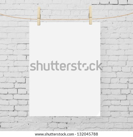 brick wall and blank poster - stock photo