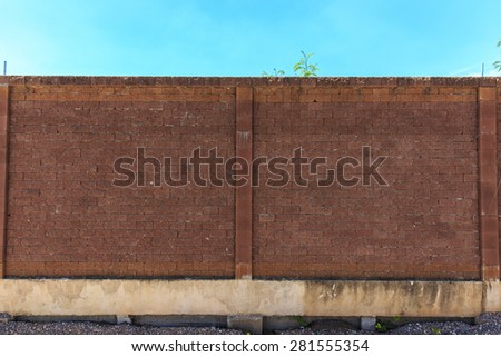 brick wall and blue sky - stock photo