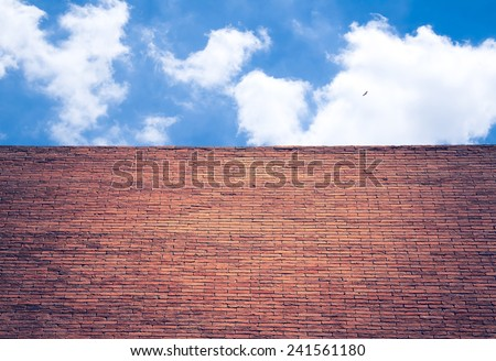 brick wall and blue sky - texture pattern exterior concrete construction - stock photo
