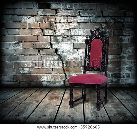 brick wall and chair