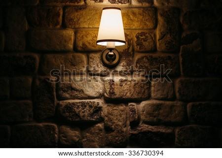 brick wall and lamp - stock photo